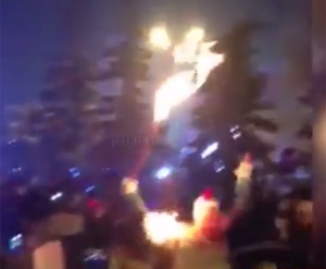Russian torchbearer's jacket catches fire in the city of Abakan